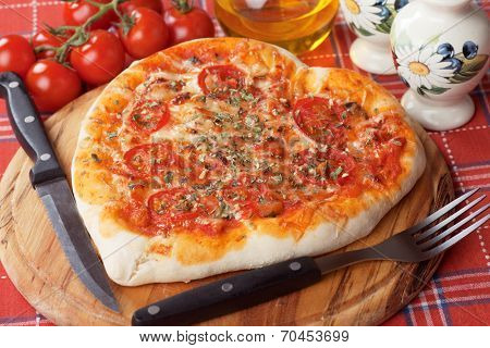 Heart shaped pizza margherita with cherry tomato and cheese