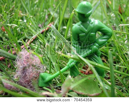 Toy ARMY Man Scanning Debris