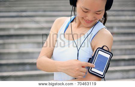 Runner athlete listening to music in headphones
