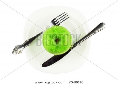 Fork, Knife, Green Apple On White Dish