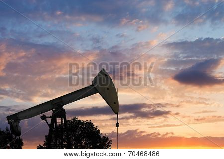View Of Pumpjack Pumping Oil At Sunset