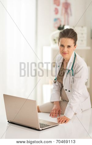 Doctor Woman With Laptop In Office