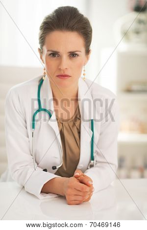 Portrait Of Confident Doctor Woman In Office