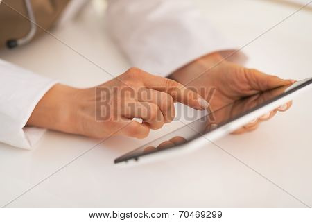 Closeup On Doctor Woman Using Tablet Pc