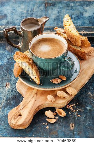 Coffee Cup And Cantucci On Blue Background