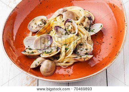 Seafood Pasta With Clams Spaghetti Alle Vongole On Orange Plate