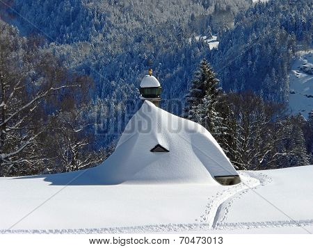 Snowbound Chapel In The Austrian Alps