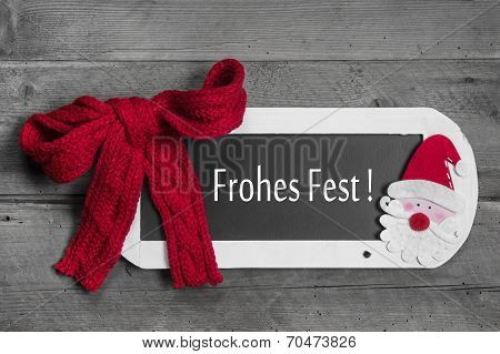 Red Bow On Menu Board With Merry Christmas - Frohes Fest - German Message On Wooden Background