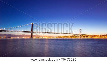 panorama of Lisbon cityscape and the 25 de Abril Bridge, Portugal