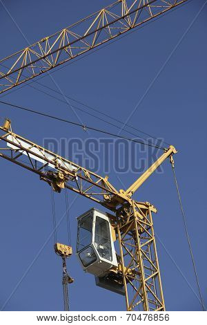 Building Crane With Steeple Cab, Against Blue Sky