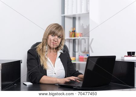 Woman Is Sitting Behind A Notebook