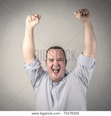 successful businessman jubilating with his hands up