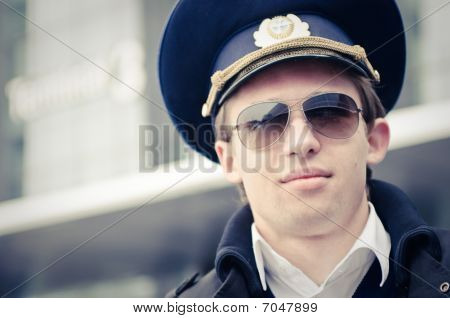 Young Pilot In Kastrup Airport Against Terminal Three, Copenhagen