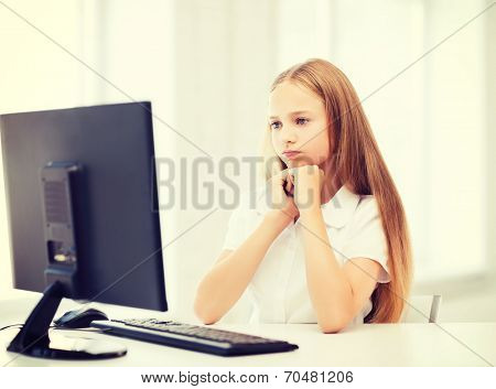 education, school, technology and internet concept - little student girl with computer at school