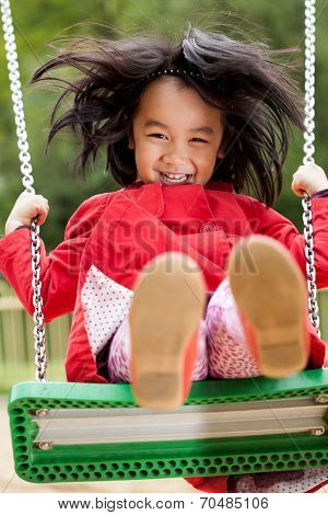 Asian Girl On A Swing