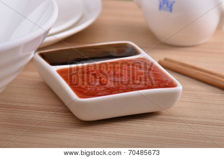 Oyster sauce and ketchup at the dinner table