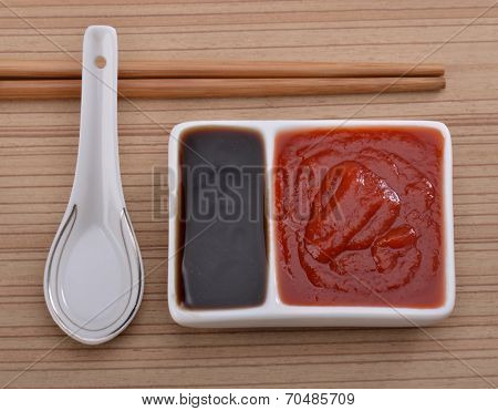Oyster sauce and ketchup on the table