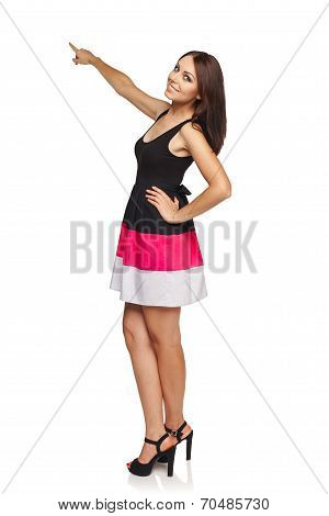 Woman pointing at blank copy space