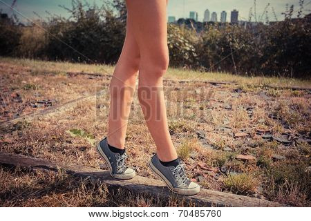 Young Woman Walking On Her Tip Toes
