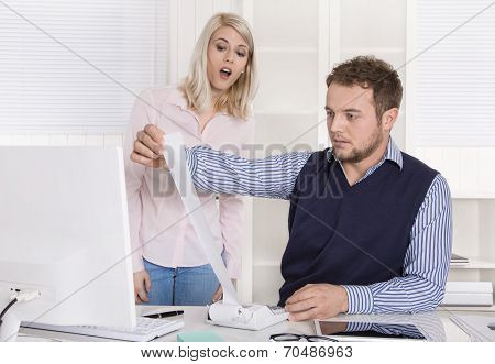 Shocked Businessman Sitting At Desk Controlling Expenses And Outgoings.