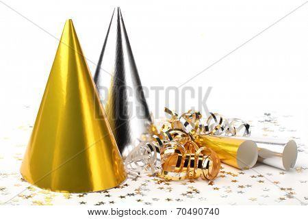 Party hats,paper streamer and confetti on white background