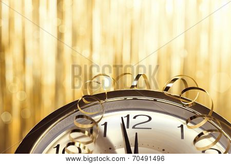 New year clock on festive background
