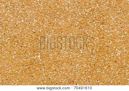Texture Of Yellow Pebble Wall For Pattern And Background