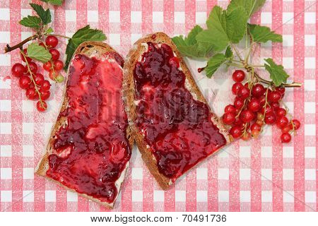 Bread Slices With Red Current Jam On Nostalgic Checkered Slat, Rustic Breakfast