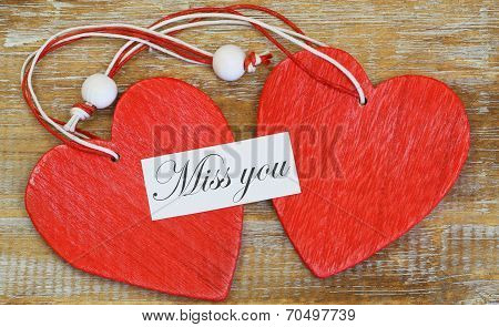 Miss you card with red wooden hearts