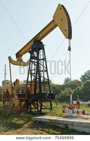 Pumpjack Pumps Oil In Foothills Of Caucasus