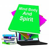 image of holistic  - Mind Body And Spirit Book Stack Laptop Showing Holistic Books - JPG
