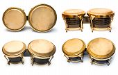 foto of timpani  - Collection from fours brown drums isolated on white background - JPG
