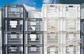 pic of picking tray  - piled up empty plastic crates on an industrial area - JPG