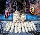 image of ganesh  - Buddha and Ganesh heads and other souvenir masks in the shop of Patan Kathmandu valley Nepal - JPG
