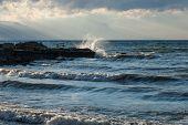 image of senators  - waves breaking on the ruins of the ancient Roman senate in Lake Iznik - JPG