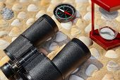 stock photo of wind up clock  - Vintage Binoculars Compass Hourglass and Seashells - JPG