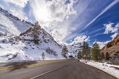 pic of breathtaking  - Sun above a mountain road in Zion National Park Utah USA - JPG