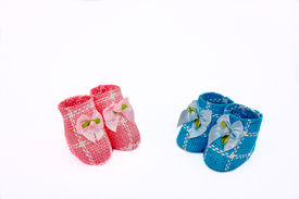 pic of twin baby  - Pink and Blue Baby Booties on the white background - JPG