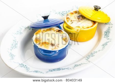 Bowls Of Onion Soup On Serving Dish