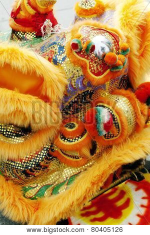 Tight Shot Of Golden Chinese Lion Dancing Head