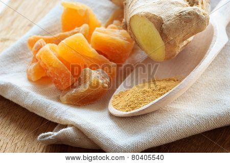 Candied Fresh And Ground Ginger On Rustic Table