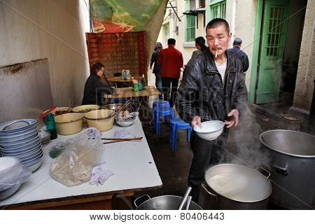 Street Food, Sidewalk Snack, Cook Prepares Outdoor, Chinese Dishes.