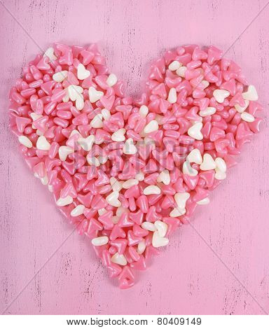 Valentine's Day Pink And White Jelly Candy Confectionary In Heart Shape On Pink Wood Background.