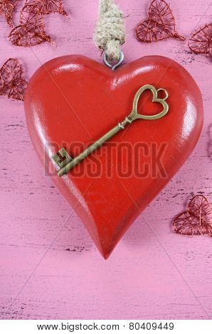 Happy Valentines Day Key To My Heart Concept With Large Hanging Heart On Shabby Chic Pink Wood Backg