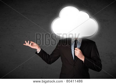 Businessman standing and hiding his head behind an empty cloud