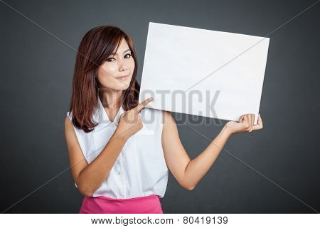 Asian Girl Point To Blank Sign