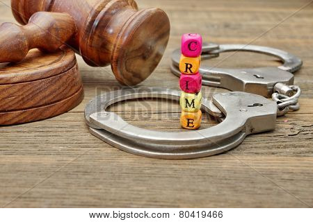 Judges Gavel, Soundboard,  Handcuffs And Sign Crime