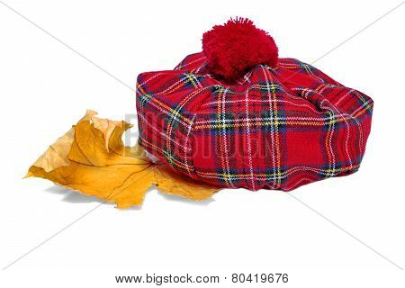 Traditional Scottish Red Tartan Bonnet And Dry Maple Leaf