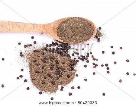 Milled black peppercorn background.