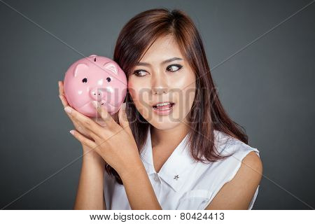 Beautiful Asian Girl Wonder How Much Money In Pig Money Box